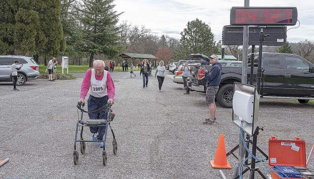 Darryl Beardall, 82, comes into the finish line in the 5K run.