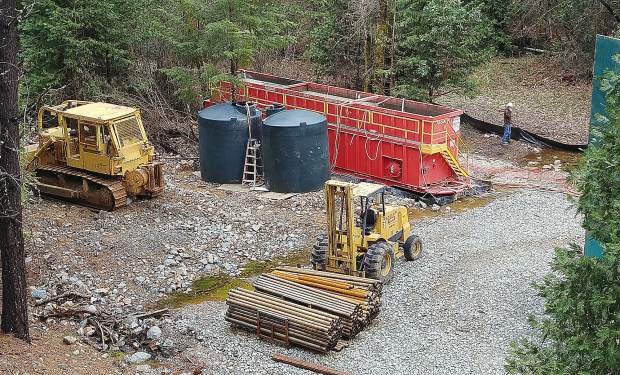Fluids used in the exploratory drilling process are retained on site in a red container.