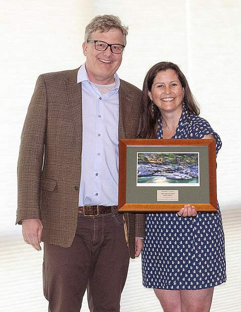 John Svahn, Associate Director of Truckee Donner Land Trust, receiving the SYRCL's Partner of the Year award from Rachel Hutchinson, River Science Director.