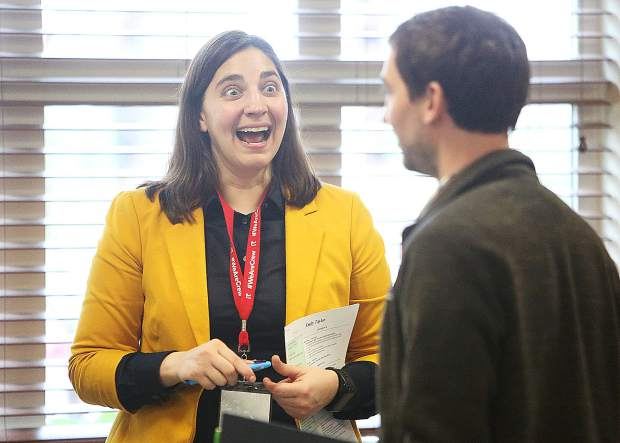 Sierra Academy of Expeditionary Learning's founding principal Erica Crane gets animated as she meets potential employee prospects during the Nevada County Schools job fair held Saturday at the Nevada County Superintendent of Schools office in Grass Valley.