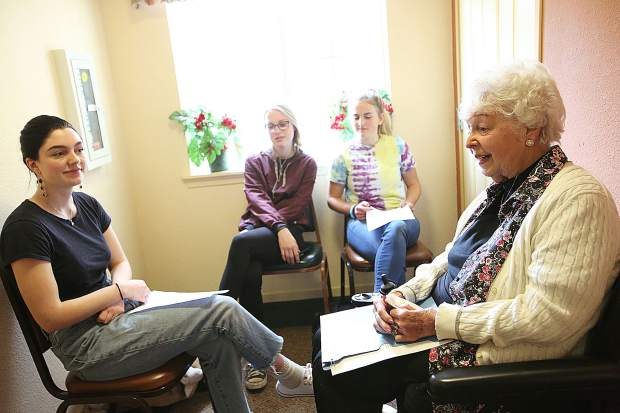 Sierra Academy of Expeditionary Learning students Carly McVay (from left), Madison Schindler and Grace Austermiller sit with Eskaton Grass Valley resident Brenda Heeke during the final day of their seniors connecting with seniors program. The program paired high school seniors with senior citizens helping to bridge the generational gap.
