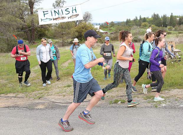 Runners test their might with the rugged 10K Salmon Run.