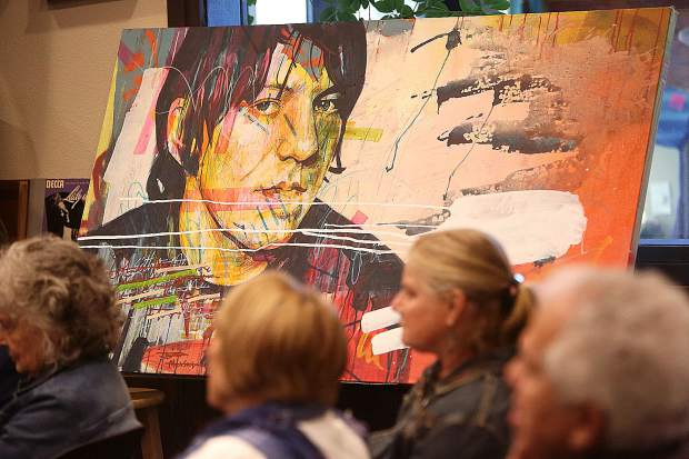 Art from Dylan Tellesen filled the community room where Tuesday's suicide awareness forum was held.