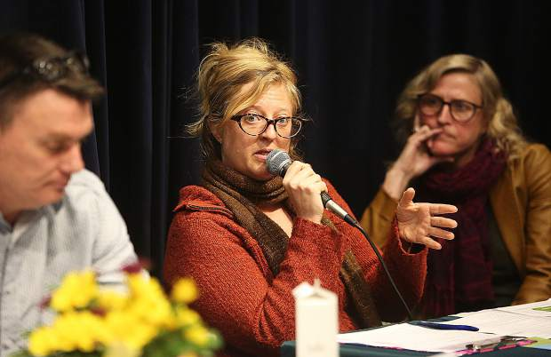Jennifer Winders of What's up Wellness speaks alongside Curtis McMullan and Shellee Sepko during Tuesday's suicide awareness town hall meeting.