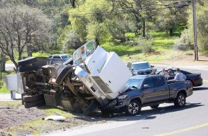 Landscape truck rolls over at McCourtney Road and Indian Springs Road (VIDEO)