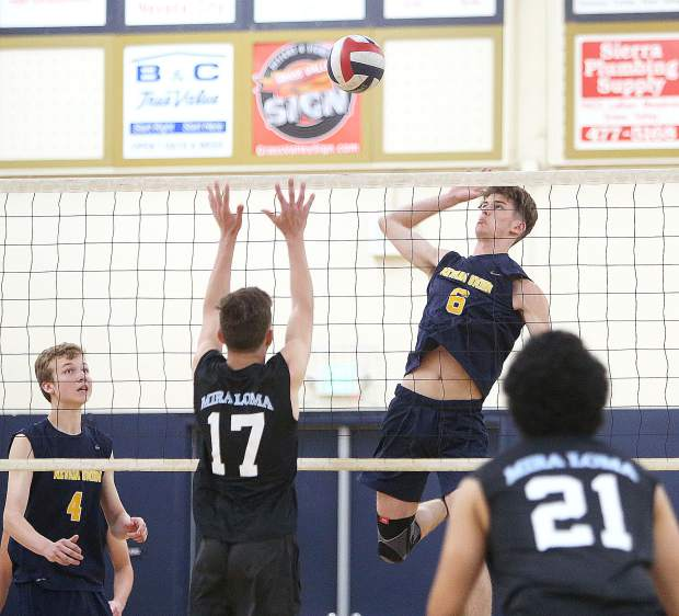 Nevada Union High School senior Carter Depue (6) slams one of his spikes over the net past a pair of Mira Loma defenders during Tuesday's first round boys volleyball playoff win over the Matadors in three straight sets.