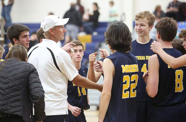 Nevada Union High School varsity boys volleyball head coach Lance Mansuetti congratulates his team following their first round playoff win in three straight sets over the Mira Loma Matadors.
