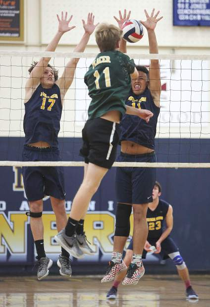 Nevada Union's Bakir Torkman (17) and Cameron Dallago (11) block Placer's Zac Rohde (11) during the Miners' win Tuesday. Dallago tallied five blocks and Torkman notched two.