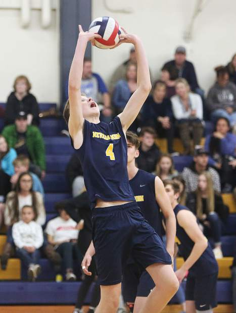 Nevada Union junior Colby Quiggle sets a ball during Tuesday's matchup against the Placer Hillmen.