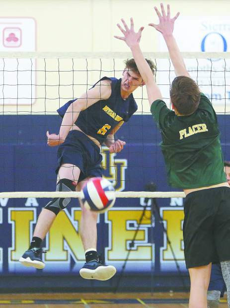 Nevada Union High School boys volleyball head coach Lance Mansuetti talks to his team in between sets during Tuesday's matchup against the Placer Hillmen.