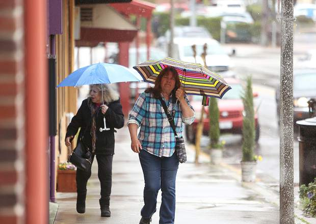 Folks didn't let Tuesday's rain showers stop them from getting out and about in downtown Grass Valley for some casual window shopping.