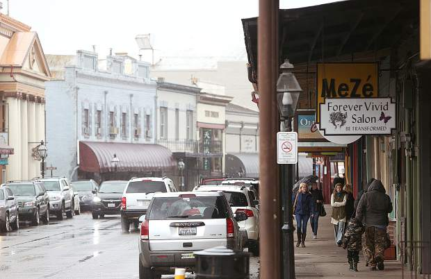 Downtown Grass Valley was bustling Tuesday afternoon despite intermittent rain showers.