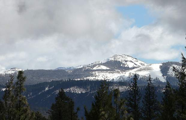 Snow covered Fall Creek Mountain rises to 7,490 feet in the Tahoe National Forest as visible from the Washington overlook from Highway 20. Snow levels dropped to about 5,500 feet elevation Monday night and left 1 to 3 inches at 7,000 feet.