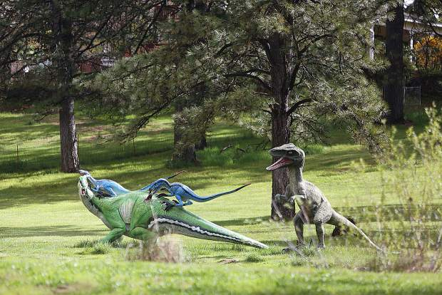 The dinosaur sculptures off of Sky Pines Way in Alta Sierra seem to welcome a break in the rain Tuesday morning.