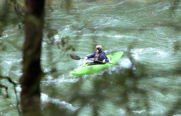 A kayaker paddles through the waters of the South Yuba River in Nevada County Thursday near Purdon Crossing. Experienced kayakers utilize the high flows of the South Yuba to enjoy the class III IV and V rapids.