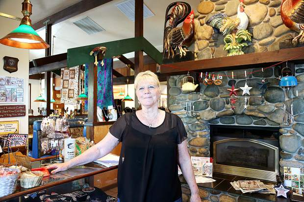 Paulette Rickard stands in the entry way of her restaurant, Paulette's Country Kitchen, which has been in operation in the Glenbrook Basin for 30 years.