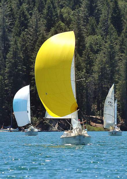 Randy Pawlowski, with the gold sail of his Gold Rush Catalina 22, leads a group of sail boats to the finish line during a round of racing at the Gold Country Regatta at Scotts Flat Reservoir.