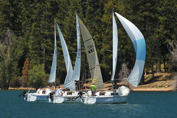 A trio of Catalina 22's jockey towards the finish line for a shot at third place during the first round of Gold Country Regatta sail boat racing. The annual occurrence took place Saturday and Sunday at Scotts Flat Reservoir in Nevada County.