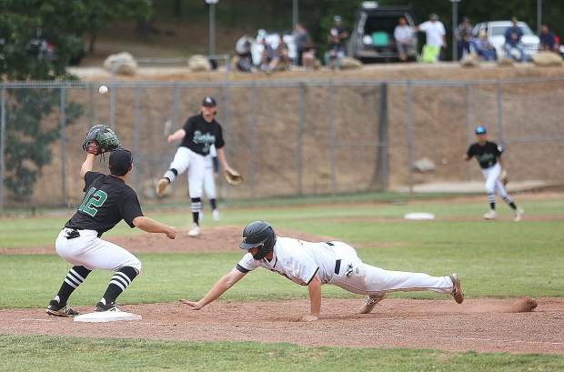 Nevada Union High School baserunner Nick Noll (49) hurries to get back to first base as Rio Americano attempts to pick him off.