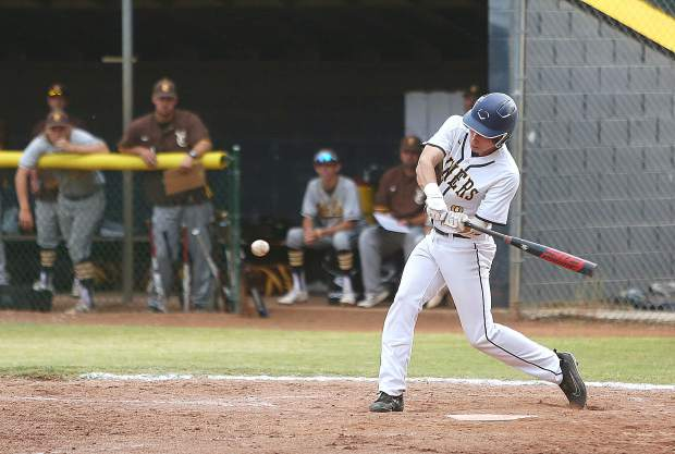 Nevada Union's Noah Sims (8) puts the ball into play and gets on base with this base hit against the Yuba City Honkers.The Miners will host Rio Americano in the first round of the Division III playoffs Tuesday.