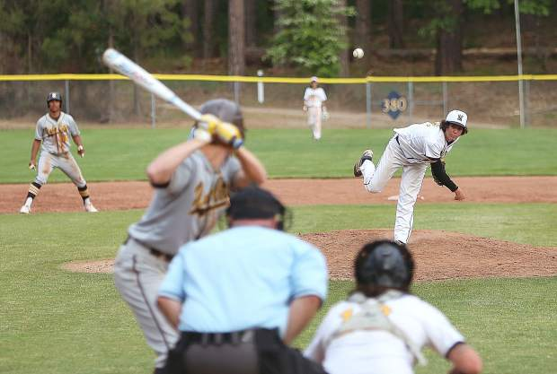 Nevada Union varsity Miners' relief pitcher (16) fires a pitch while a Yuba City base runner awaits the outcome.  The Miners will host Rio Americano in the first round of the Division III playoffs Tuesday.