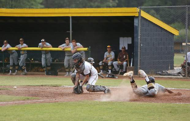 Nevada Union High School catcher Andrew Long (13) and the rest of the Miners couldn't stop Yuba City from scoring early and late in the game during Wednesday's 7-2 loss to the Honkers. The Miners will host Rio Americano in the first round of the Division III playoffs Tuesday.