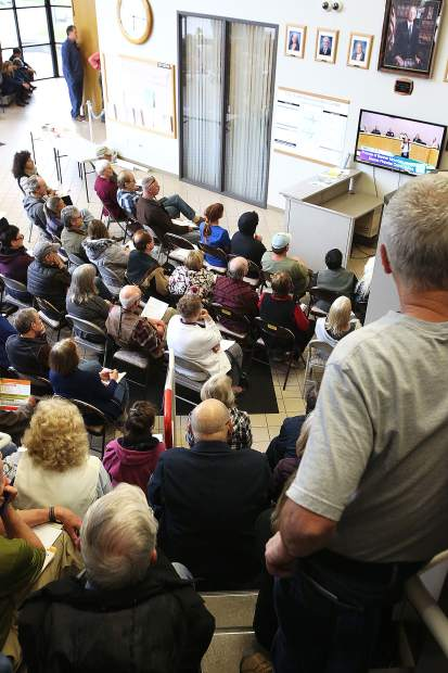 Overflow seats set up in the lobby of the Nevada County Board of Supervisors chambers were filled and folks sat on the stairs and the floor during Wednesday's wildfire meeting.