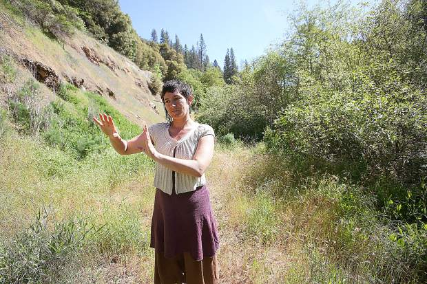 California Heritage: Indigenous Research Project Executive Assistant Ember Amador stands in front of the former production area of the Champion Mine near Nevada City where 32 acres of land were recently allocated to the indigenous research organization.