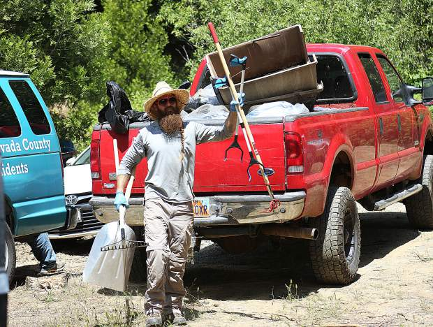 Grass Valley Growers' Jon Oleson grabs shovels, rakes, and other implements to assist in the California Heritage: Indigenous Research Project property cleanup on Champion Mine Road Thursday morning.