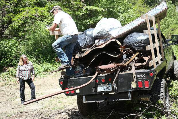 A truck full of homeless encampment refuse as well as former mining metal from the Champion Mine is ready to be hauled off of the 32-acre California Heritage: Indigenous Research Project property outside of Nevada City.