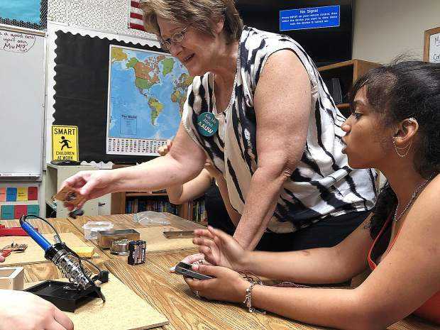 American Association of University Women-Auburn treasurer, Deb Sabo used her former experience in science and technology to teach Sierra Montessori Academy students to construct phone chargers.