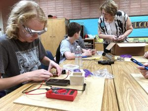 Fully charged: Girls and boys learn to build phone chargers at Sierra Montessori Academy