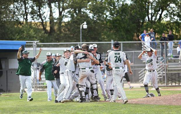 Colfax High School varsity baseball players rush the mound after winning the section championship game over the Bear River Bruins Monday at American River College in Sacramento.