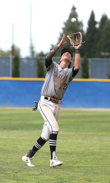 Bear River infielder Nathan Van Patten catches a pop fly for an out against the Colfax Falcons.