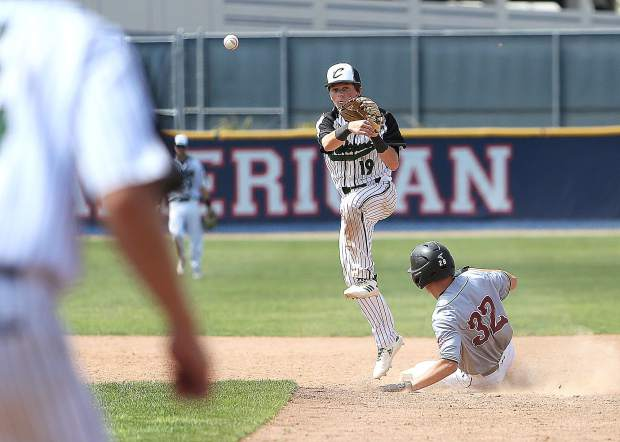 Colfax junior Mike Lavigne (19) tries to turn a double play after ousting Bear River baserunner Devin Ortiz (32) at second base.