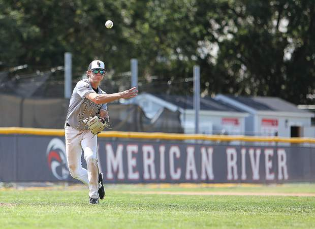 Bear River's Colby Lunsford fires a throw to the infield during Monday's matchup against Colfax.