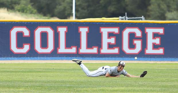 Bear River outfielder Logan Jenkins just misses a diving catch during Monday's second game against the Colfax Falcons. The Bruins won the first game against the Falcons forcing a double elimination game to ensue.