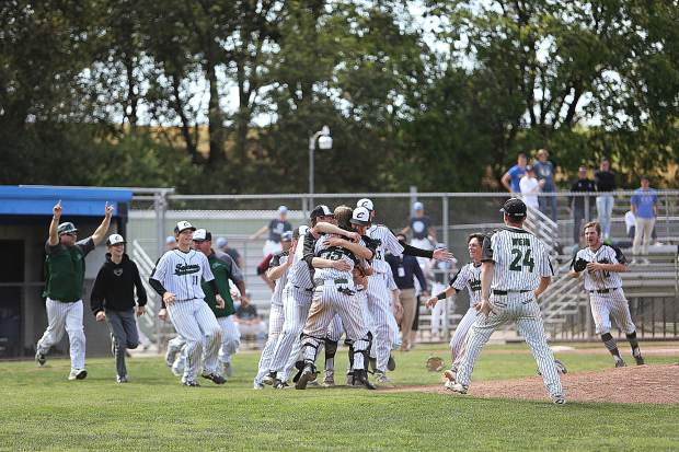 Colfax High School baseball players rush the mound after winning a double elimination section title game over the Bear River Bruins Monday at American River College in Sacramento.