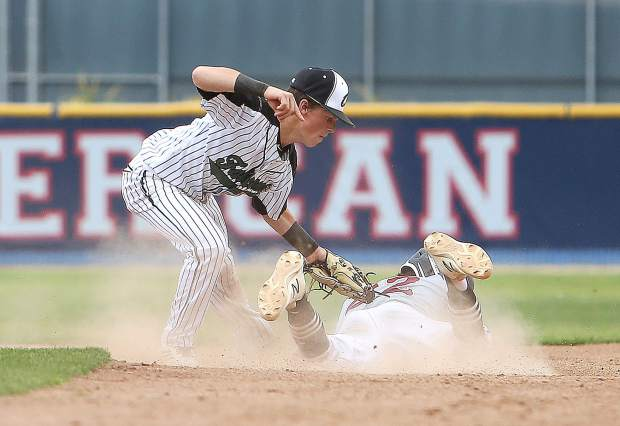 Bear River's Nathan Van Patten is tagged out at second base by Colfax junior Mike Lavigne during Monday's section title matchup at American River College in Sacramento.