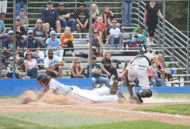 A Bear River baserunner is tagged out as he slides over home plate during Monday's section title baseball game against the Colfax Falcons.