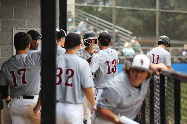 The Bruins' dugout congratulate each other after scoring a run against the Colfax Falcons on Monday.