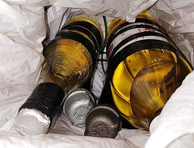 Two of the IEDs found inside a Grass Valley residence Saturday used bottles filled with a flammable liquid.