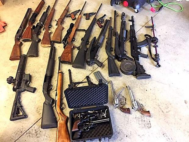 Yuba County Sheriff's deputies served a search warrant in Dobbins and confiscated more than two dozen firearms last week.