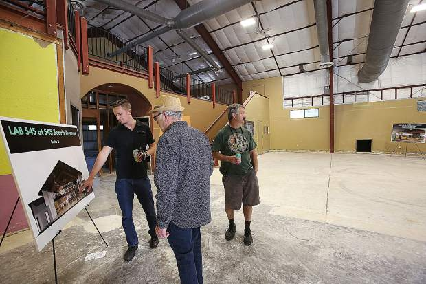 LAB Properties leasing analyst Trent Hullen leads a group of potential cannabis investors through the empty spaces of the former South Yuba Club on Searls Avenue, now being dubbed the cannabis campus.