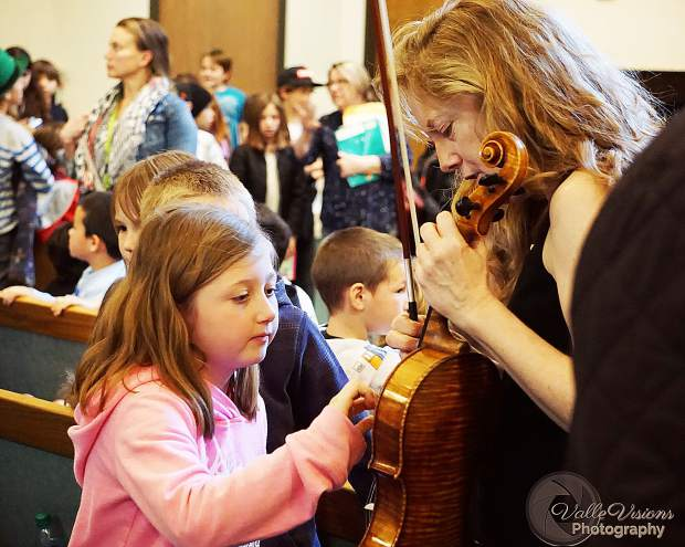 Kylee White, 9, gets the opportunity to talk to St. Lawrence String Quartet violist Lesley Robertson after the Third Grade Education Concert in March, presented by InConcert Sierra.