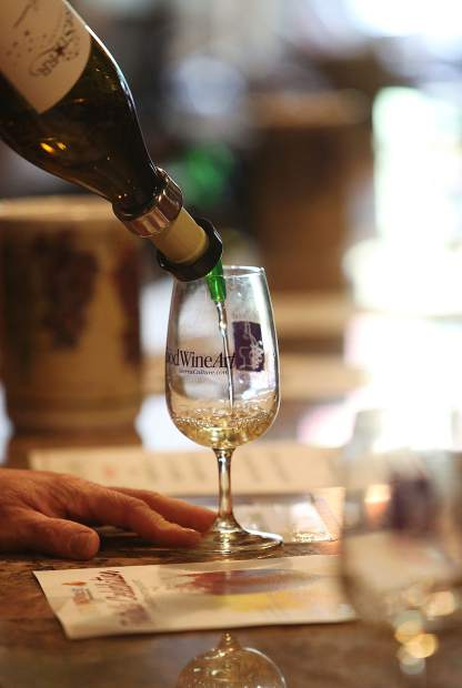 A glass of wine is served during Saturday's Foothills Celebration.