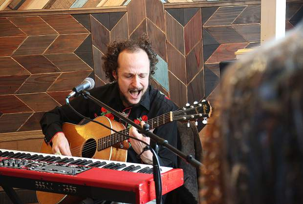 Graham Patzner, Whiskerman, plays guitar keyboard and sings during Saturday's Foothills Celebration from inside Sunchild's Parlour.