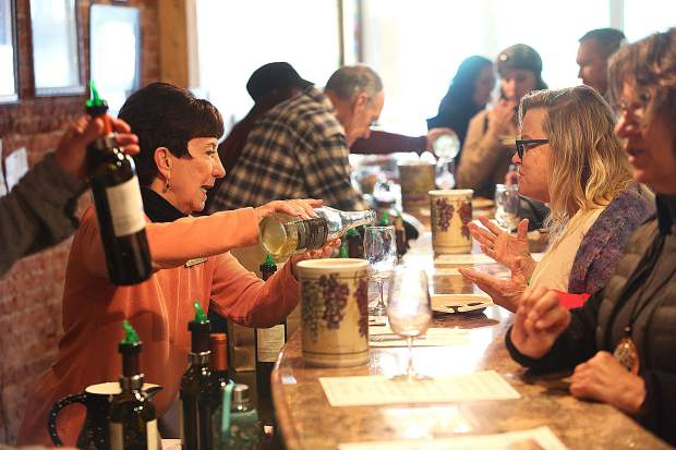 Sierra Starr Winery's Lynn Kremer pours for participants of Saturday's Foothills Celebration.