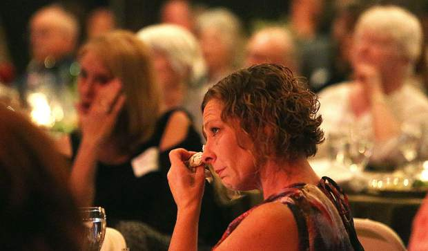 Tears are blotted away during the intimate speeches of trials and tribulations that they young Friendship Club graduates gave during a dinner Thursday night at the Miners Foundry.