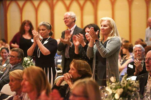 The Friendship Club grads are given a standing ovation following their individual speeches during Thursday's graduation gala at the Miners Foundry.